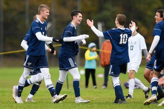 Essex celebrates a goal by Tyler Routhier (16) during the boys soccer play down game between the Rice Green knights and the Essex Hornets at Essex High School on Tuesday afternoon October 23, 2018 in Essex.