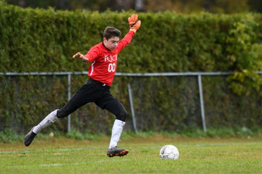 Rice goalie Owen Greene (00) kicks the ball during the boys soccer play down game between the Rice Green knights and the Essex Hornets at Essex High School on Tuesday afternoon October 23, 2018 in Essex.