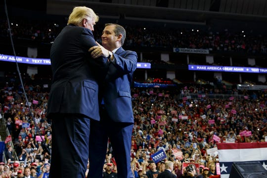 President Donald Trump is greeted by Sen. Ted Cruz, R-Texas, as he arrives for a campaign rally at Houston Toyota Center, Monday, Oct. 22, 2018, in Houston. (AP Photo/Evan Vucci)