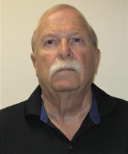 Donald Horner, former president of the Delran Emergency Squad, is charged with insurance fraud and other crimes.
