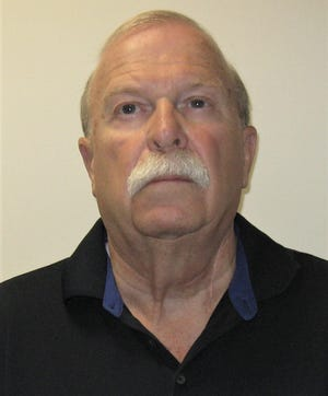 Donald Horner, former chief of the Delran Emergency Squad, has been charged with insurance fraud and other crimes.
