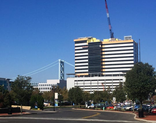 An office tower rises on the Camden Waterfront, where state tax incentives are fueling redevelopment.