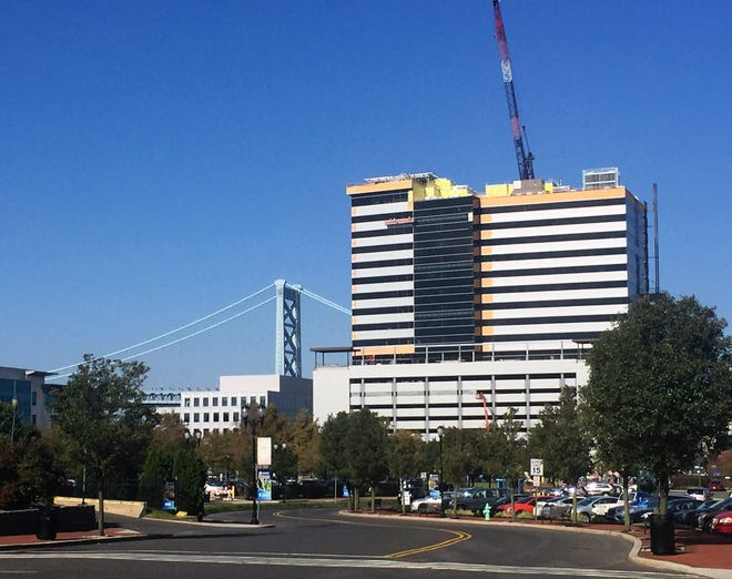 Construction continues Tuesday on an office tower rising on the Camden Waterfront.