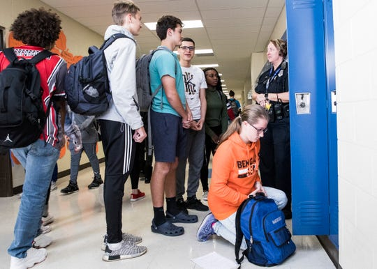 Upgrading security is a focus of a school safety levy that voters in five of Butler County's 10 districts are being asked to approve Nov. 6, 2018. Here, Chillicothe High School/Middle School resource officer Julie Preston talks with some students before seventh period.