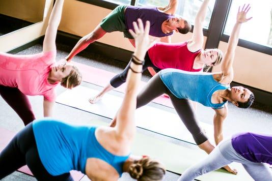 Mixed Ethnic Yoga Class In Studio