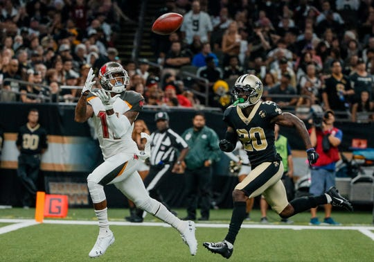 Tampa Bay Buccaneers wide receiver DeSean Jackson (11) catches a touchdown over New Orleans Saints cornerback Ken Crawley (20) in a win against the Saints 48-40.
