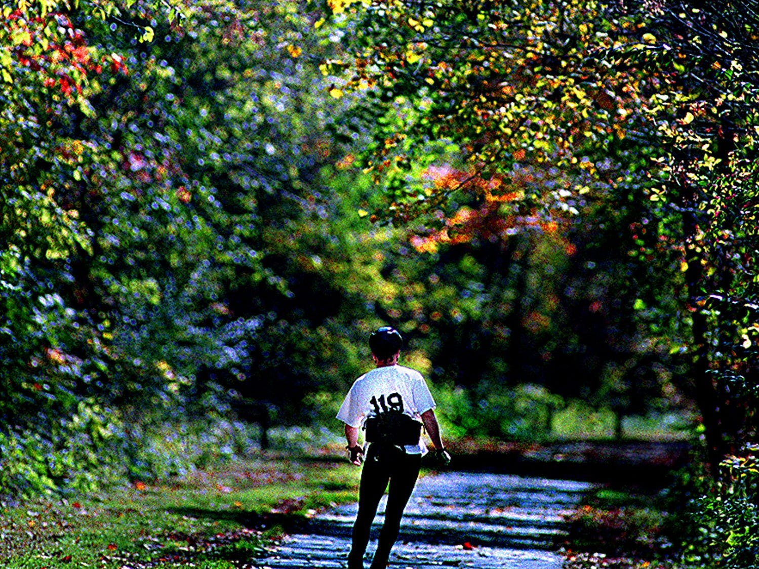 An inline skater skates along the Little Miami Scenic Bike Trail in Loveland enjoying the beautiful weather and fall foliage.