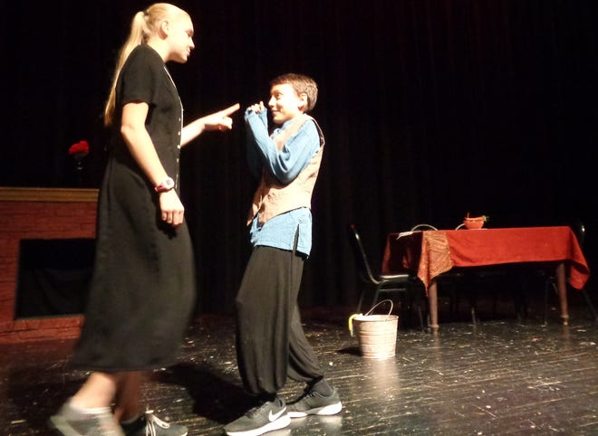 """Loveland Middle School eighth-graders Paige Libby (Mean Stepmother) and George Jewell (Cinderfella) rehearse a scene from the new original """"Cinderfella"""" by April Clark showing at LMS Auditorium Nov. 1-3."""