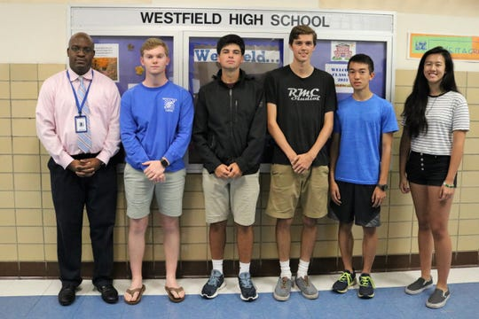 Left to right: Westfield High School principal congratulates seniors Andrew Zanfagna, Jacob Singman, Alexander McGrail and juniors Kurt Hu and Valier Chang for perfect scores on portions of the September 2018 ACT.  Senior Timothy Miller (not pictured) also received a perfect score for the science portion.