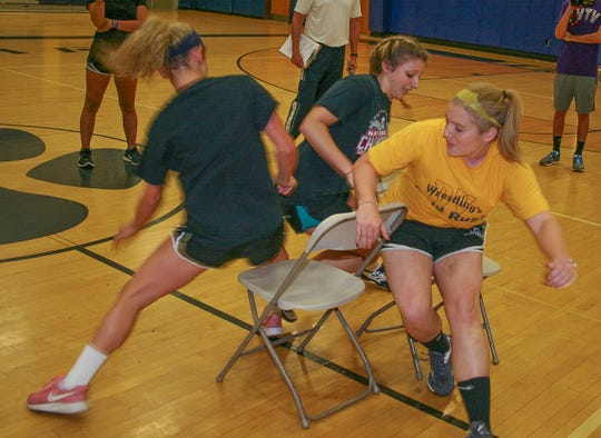 In a final round of Girls' musical chairs are, from left, Stephanie Nissel, Hannah Chiswick and Meghan Haff.