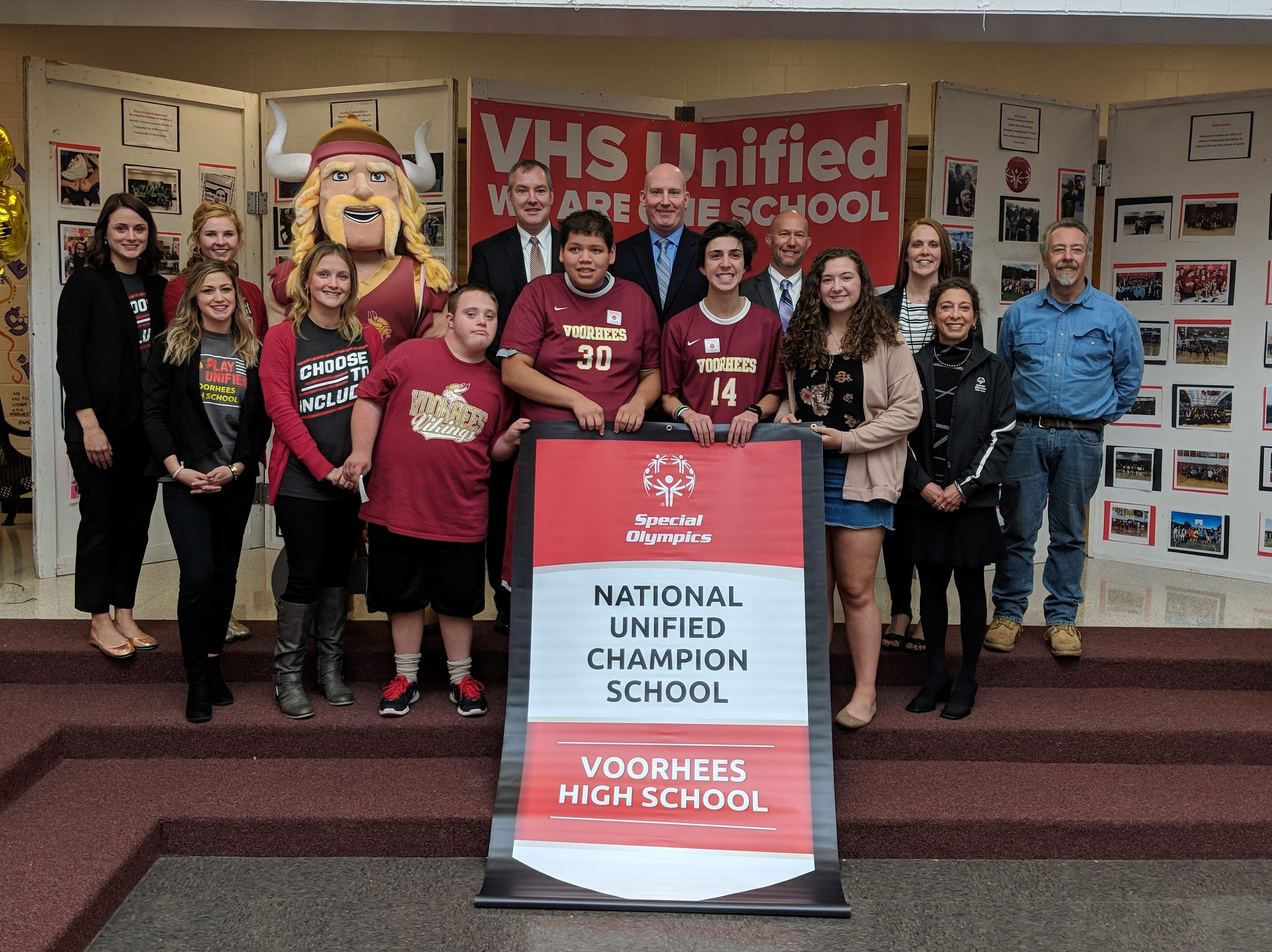 With banner, back row (L-R): Kaitlyn Collins, Sarah Cummins, Viktor the Viking, Superintendent Jeff Bender, Voorhees Principal Ron Peterson, Asst. Superintendent Rich Bergacs, Voorhees Asst. Principal Kelly Anne Kieffer, Board of Education President Francis Goger Front row (L-R): Melissa Haines, Jennifer Komoroski, Unified co-president Daniel Jordan, Unified Sports co-team captain Bruce Fujihara, Unified Sports co-team captain Alex Warner, Unified co-president Jessica Brynildsen, Susan Colacello from Special Olympics New Jersey