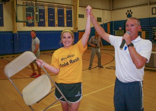 Emcee Marty White announces the champion of Mixed Musical Chairs, Meghan Haff. In the Del Val High School Senior Olympics, Musical Chairs is no party game for little kids; the Terriers play for keeps.