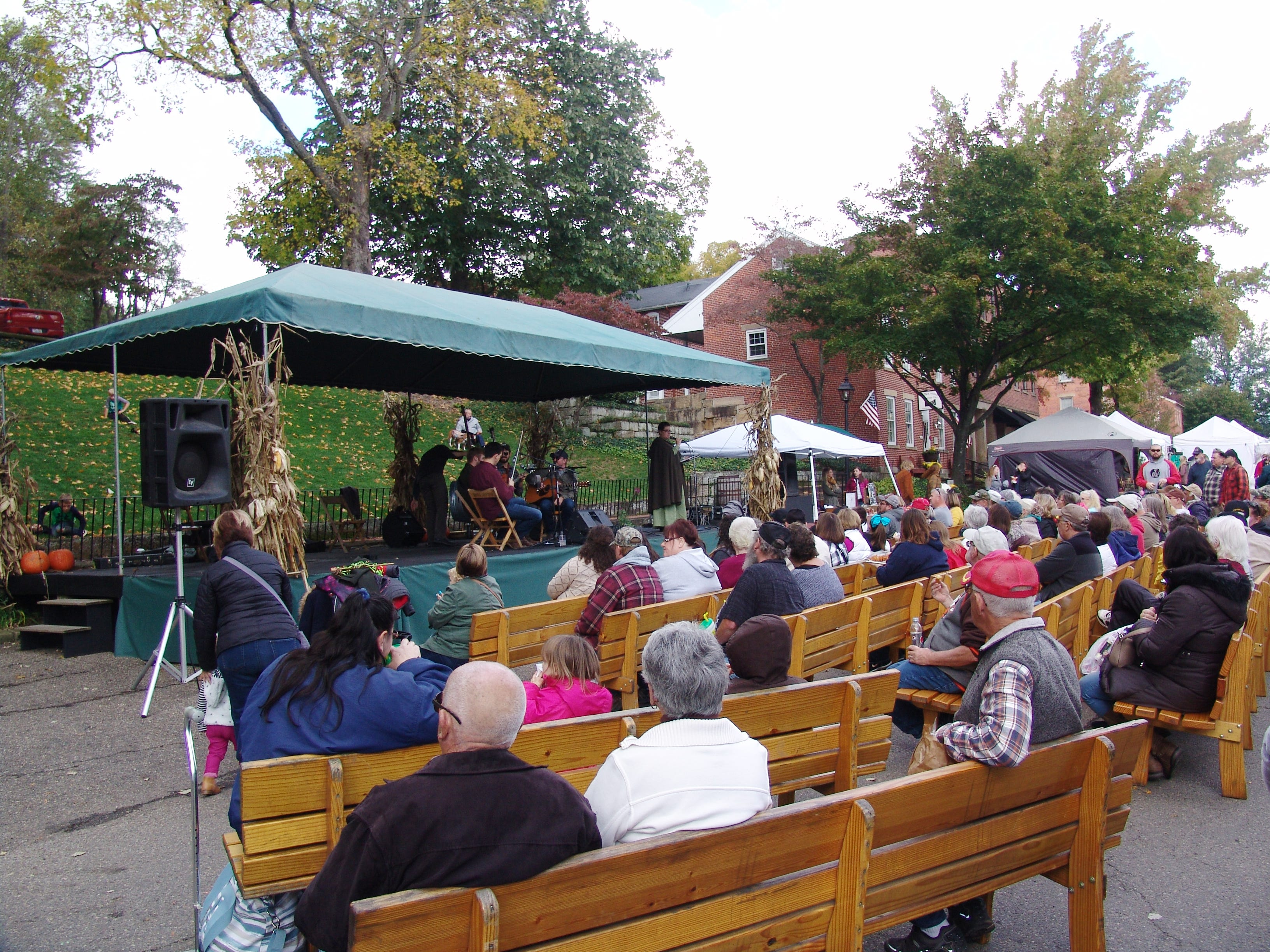 Visitors gather around the main stage at the Apple Butter Stirrin' Festival.
