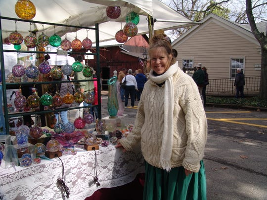 Cathy Tietz Boring of Granville has been selling her hand-blow glass and hand-thrown pottery at the Apple Butter Festival for more than 20 years, because of the number of people who attend the annual event.