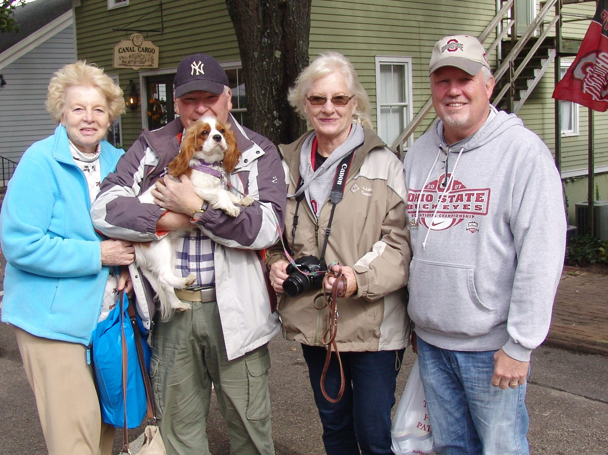 Barbara Kelly, Jerry and Gracie Kelly, Sharon Ashbaugh and Richard Ashbaugh pose for a photo during the Apple Butter Stirrin' Festival.