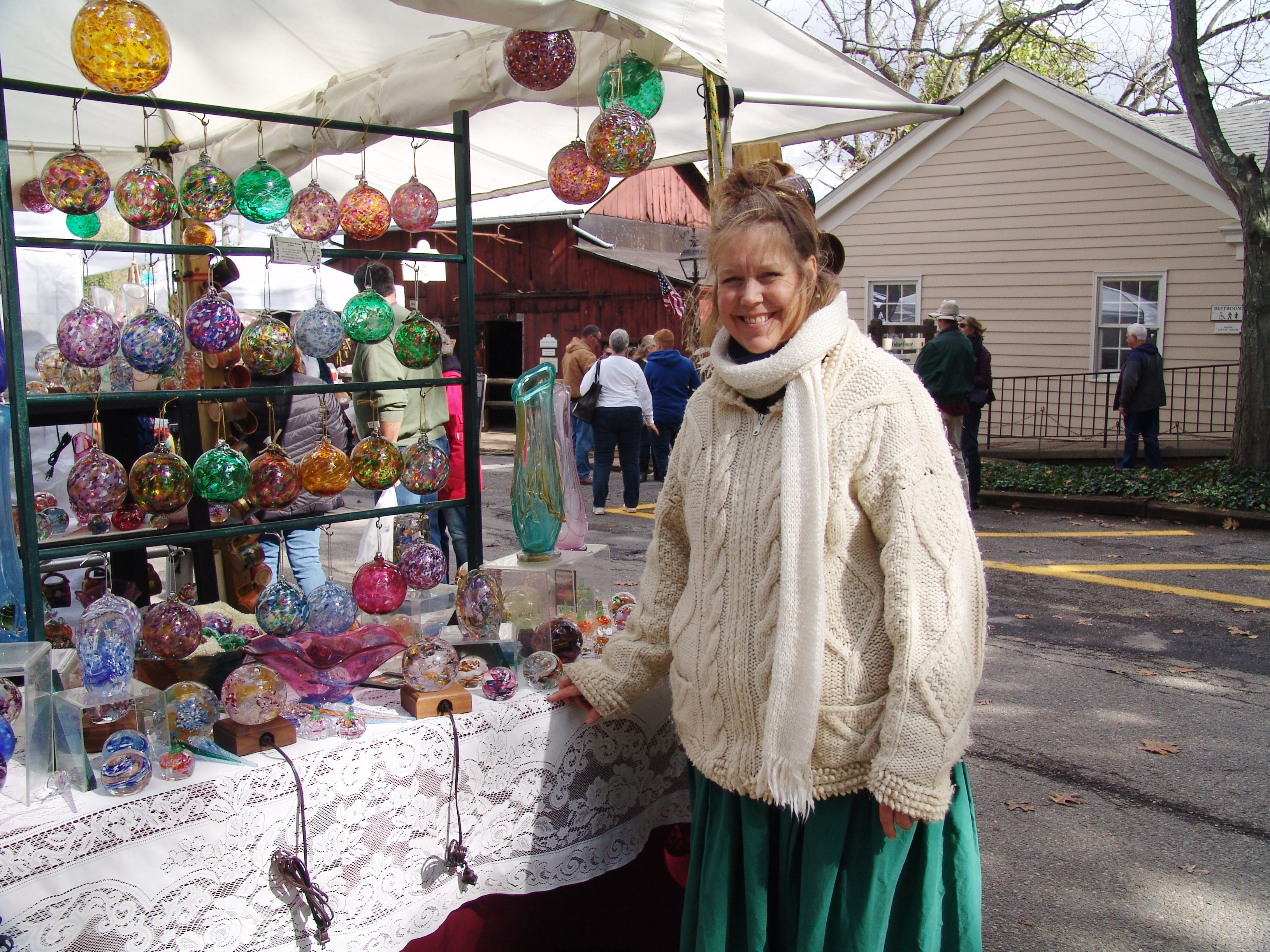 Cathy Tietz Boring poses by her booth during this year's Apple Butter Stirrin' Festival.
