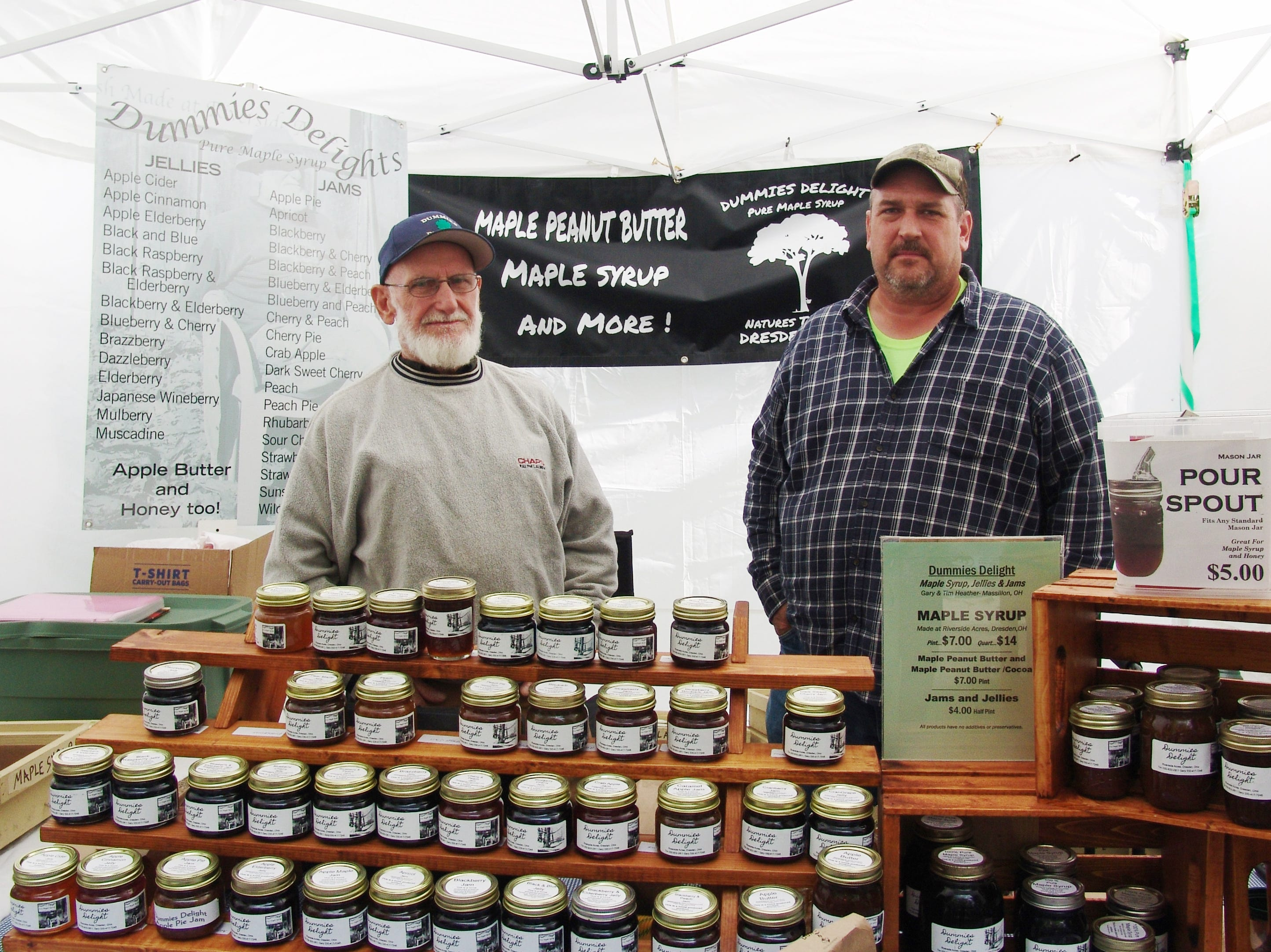 Gary and Tim Heather pose at their booth during the Apple Butter Stirrin' Festival.