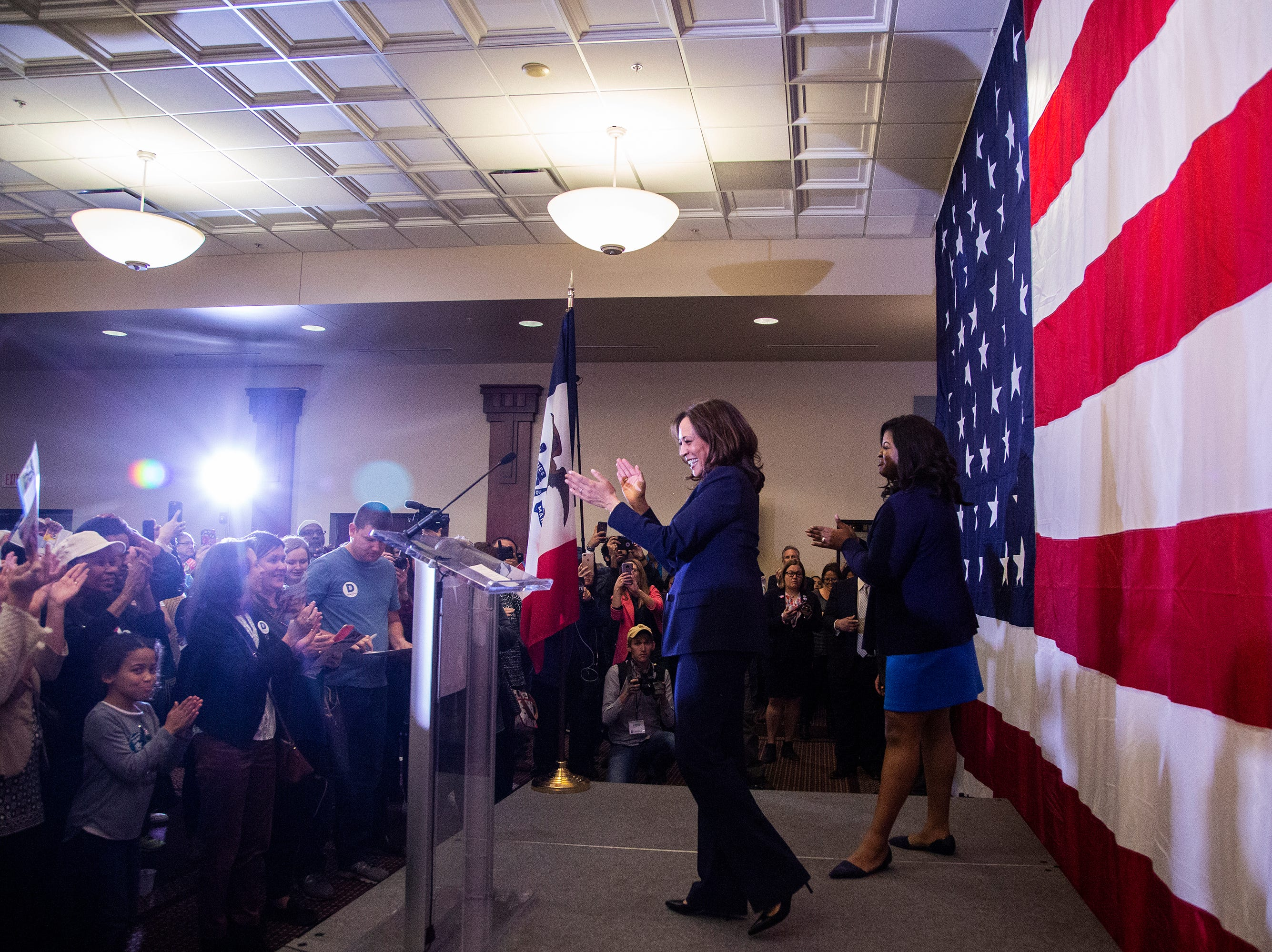 Kamala Harris, a Democrat Senator from California, and Secretary of State candidate Deidre DeJear cheer from stage at the end of a rally with Polk County Democrats on Monday, Oct. 22, 2018, in Des Moines.