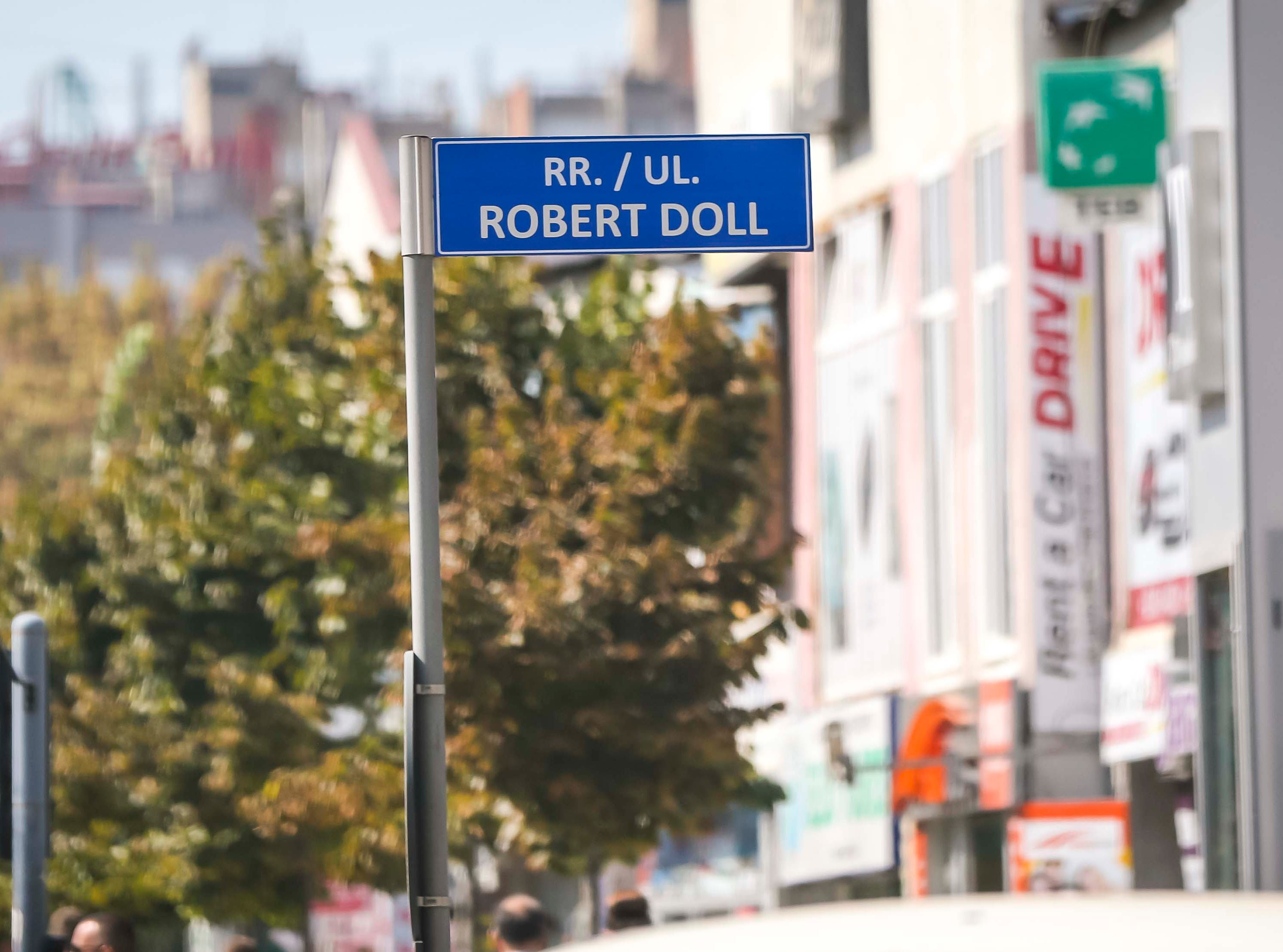 Sign for Robert (Doll) Dole Street Pristina, Kosovo, Tuesday, Sept. 18, 2018. Many streets are named for U.S. officials after NATO military involvement in the 1998-1999 conflict in the region.
