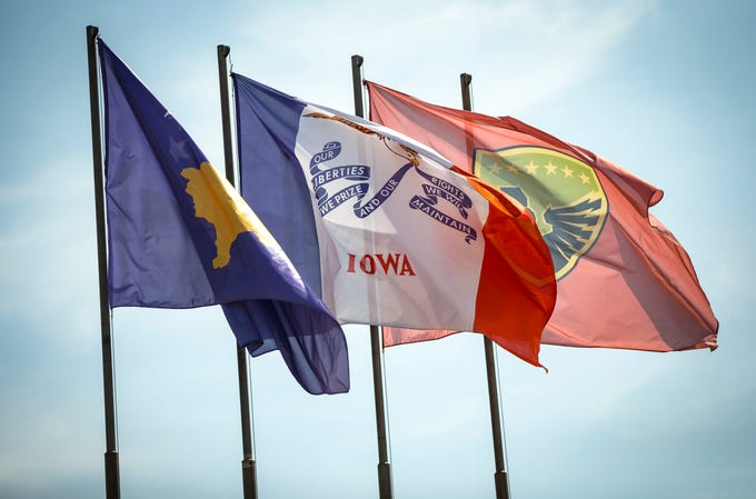 The Iowa flag flies with the flag of the Republic of Kosovo and the flag of the Kosovo Security Force at the Ministry of Defense in Pristina, Kosovo, Tuesday, Sept. 18, 2018.
