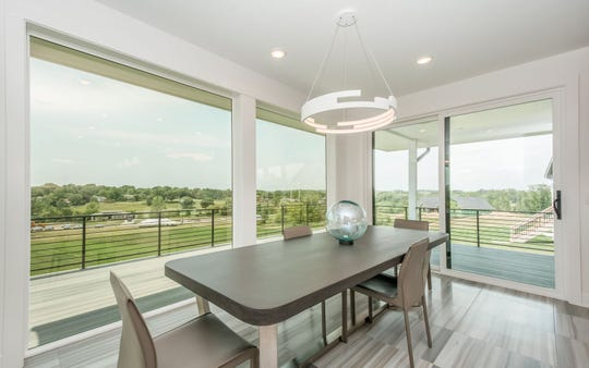 This new and automated home from a story in the Des Moines Register allows you to operate your window shades, security system, audio and video controls, temperature and more.