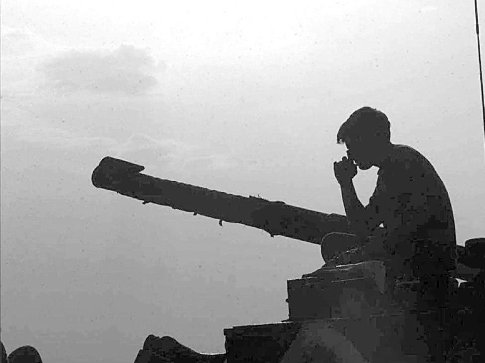 A British soldier waits at Petrovec, Macedonia, on June 15, 1999, as NATO troops prepare to cross the border into Kosovo.