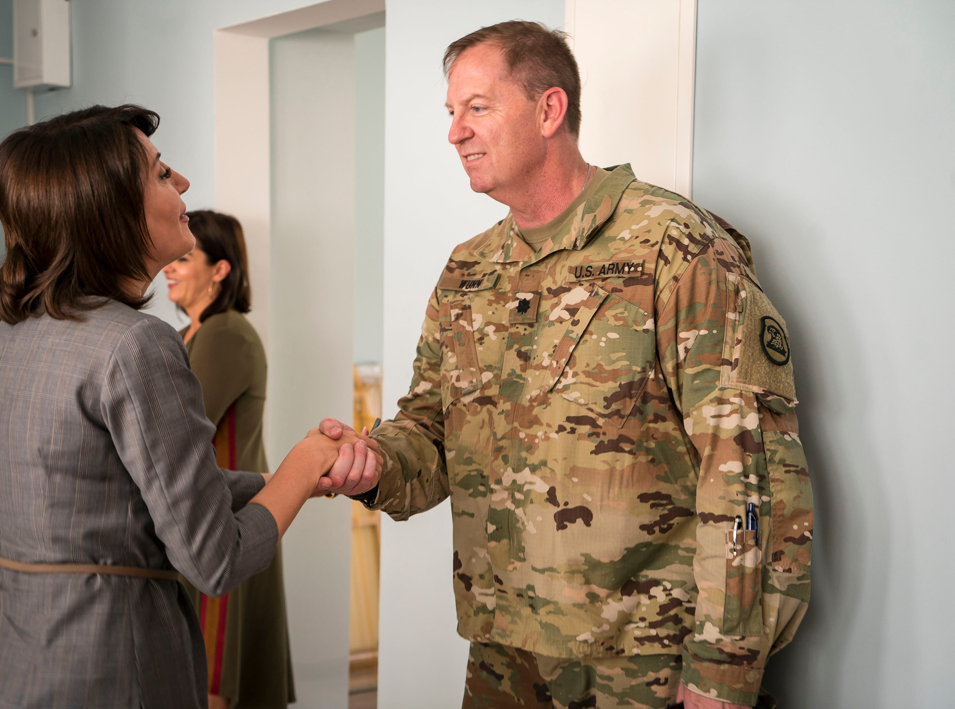 Former Kosovo president Atifete Jahjaga greets Lt. Col. Michael Wunn, former director of the Iowa-Kosovo partnership, Tuesday, Sept. 18, 2018, in Pristina, Kosovo. ÒRather than New York or Washington D.C., where they're just a small fish in a big ocean, they can come to Iowa,Ó he said. Here they Òhave more of that personal connection and access to policy makers, access to business leaders, access to the experts.Ó
