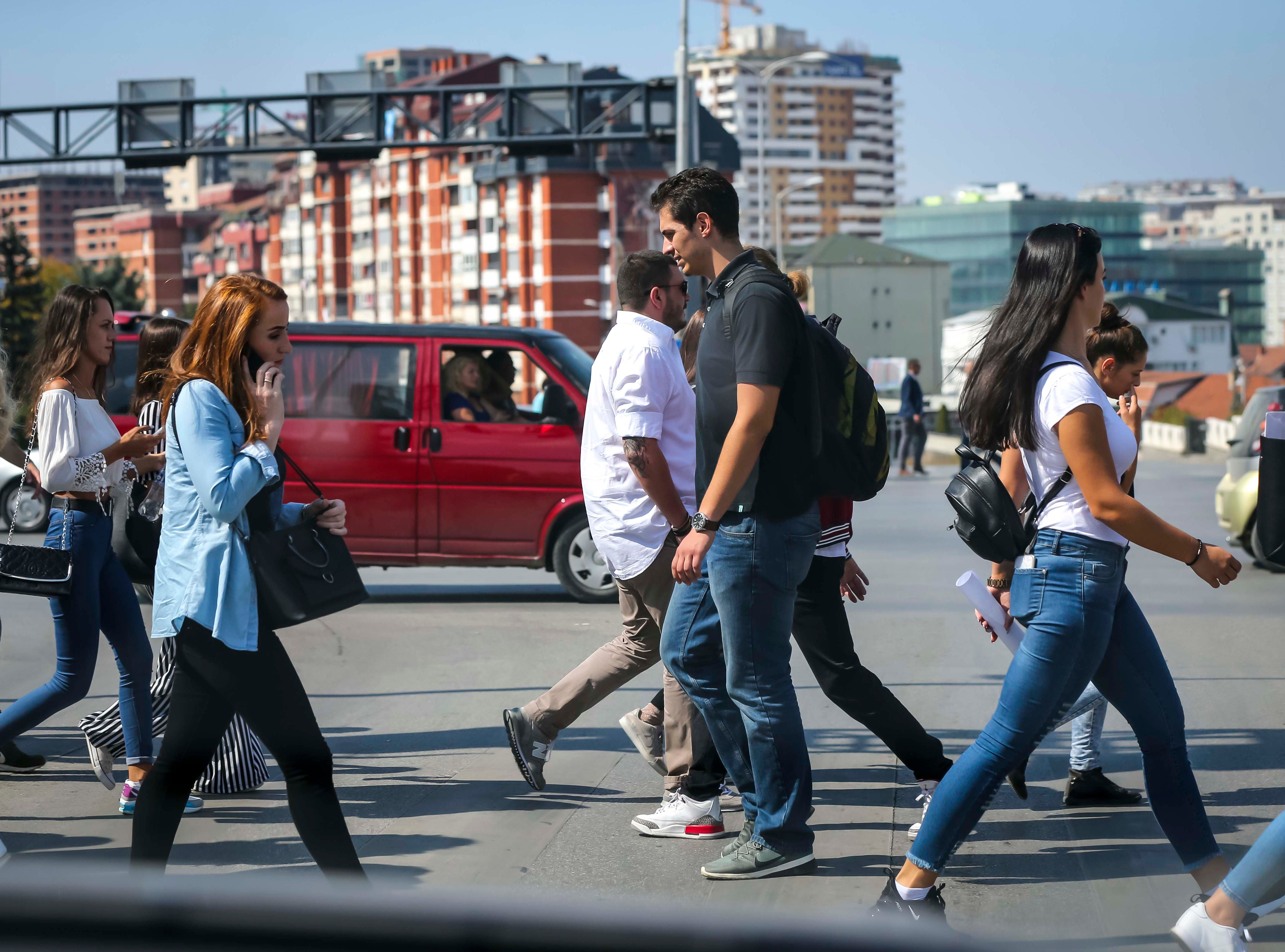 Pedestrians cross the street in Pristina, the capital of Kosovo, with a population of over 200,000.