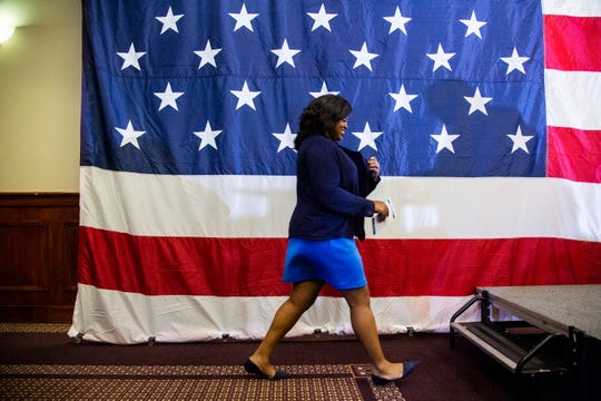 Deidre DeJear, Democrat running for secretary of state, walks up on stage to introduce Kamala Harris, a Democrat Senator from California, during a rally with Polk County Democrats on Monday, Oct. 22, 2018, in Des Moines.