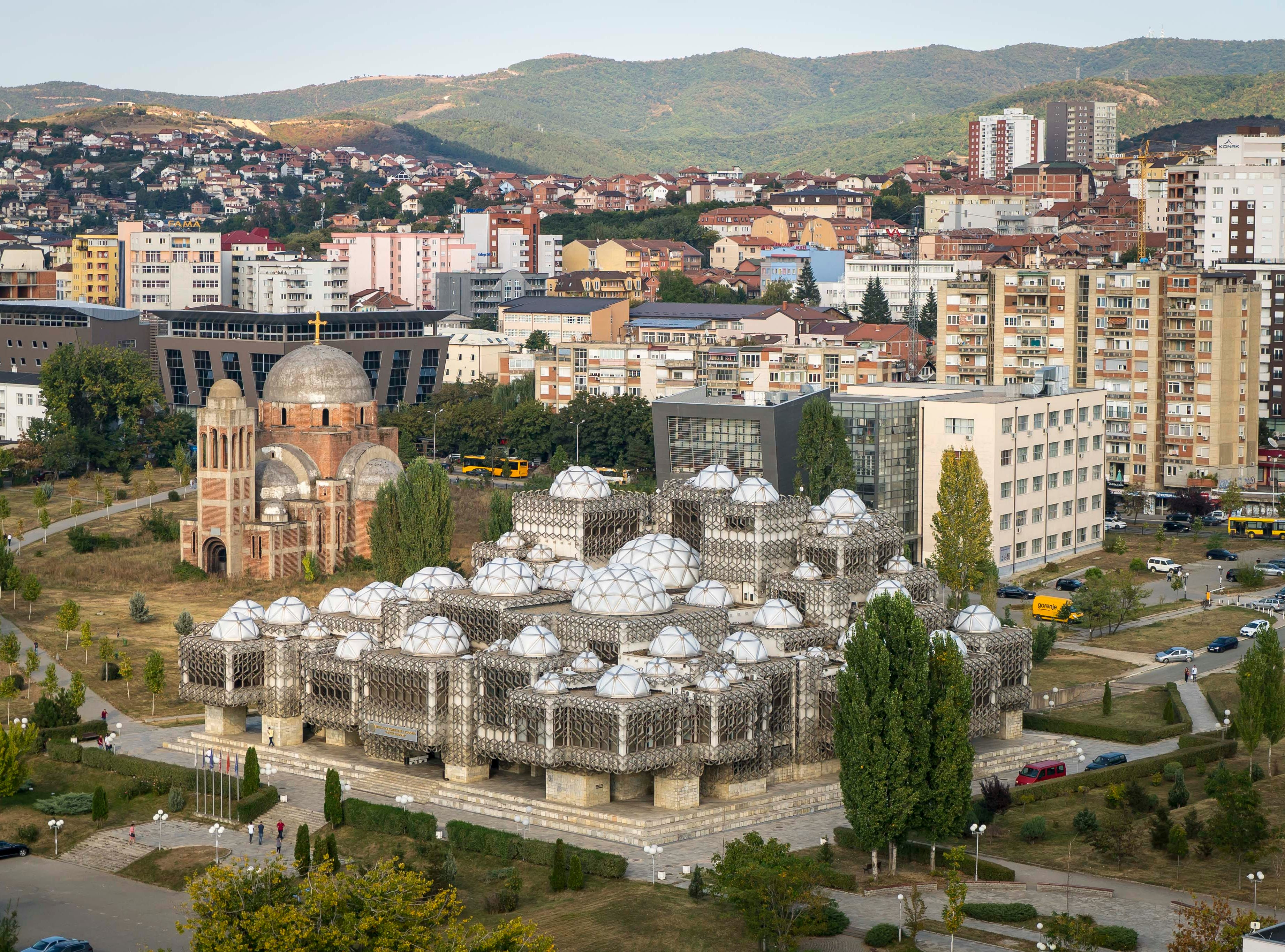 View of the National Library of Kosovo and the unfinished Church of Christ the Saviour, a Serbian orthodox christian church in Pristina, Kosovo, Tuesday, Sept. 18, 2018.