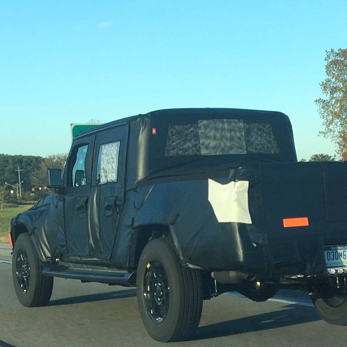 Top secret Jeep Scrambler spotted on I-94