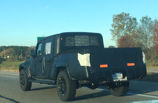 Camouflaged Jeep Scrambler undergoing testing in the Detroit area on Oct. 23, 2018.
