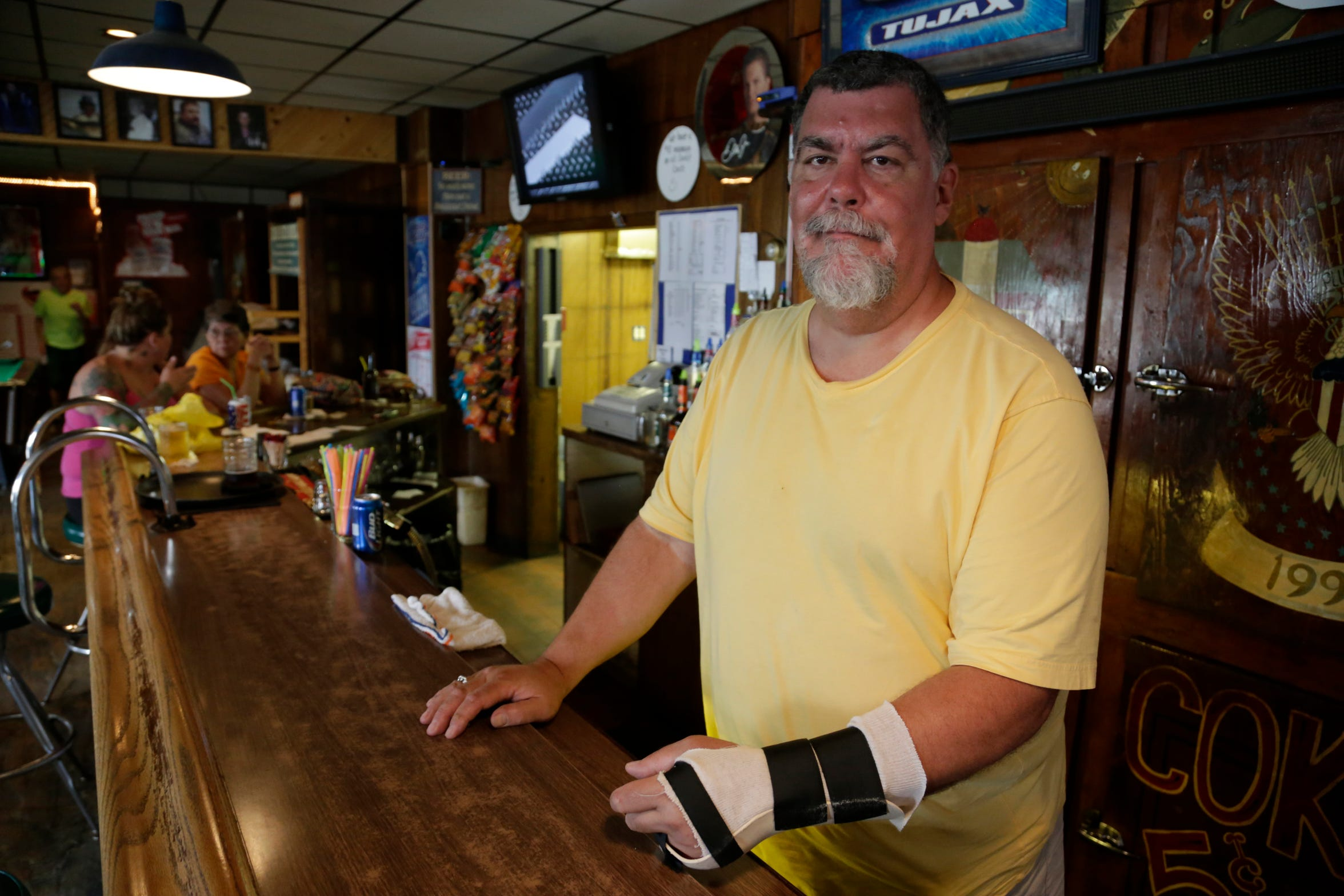 Jack Nadwornik owner of Tujax Tavern in Delton poses at his bar Wednesday June 25, 2014. Nadwornik had been celebrating his birthday when he was arrested by police in the parking lot of his bar. Police broke Nadwornik's hand, kneed him and bloodied his knees. Two of the three officers who arrested him were unpaid reserves. One of them was John Raterink, who once ran an organization identified as a hate group by the Southern Poverty Law Center.