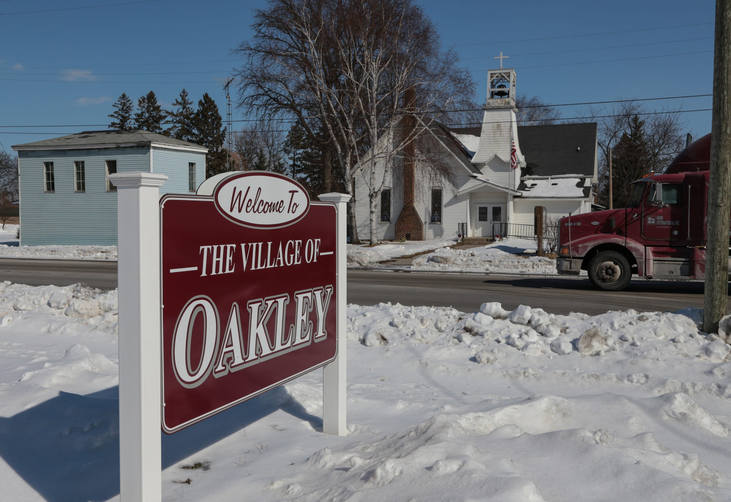 Traffic moves long Main Street in the village of Oakley, MI on Monday March 2, 2015. The small community once had nearly 150 reserve officers.