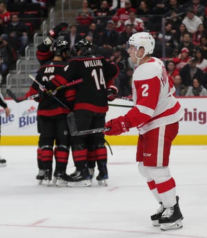Detroit Red Wings defenseman Joe Hicketts skates back to the bench after a goal by Carolina Hurricanes left wing Michael Ferland during the second period Monday at Little Caesars Arena.