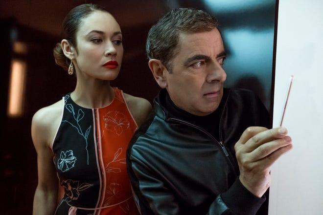 "Olga Kurylenko and Rowan Atkinson in  ""Johnny English Strikes Again."""