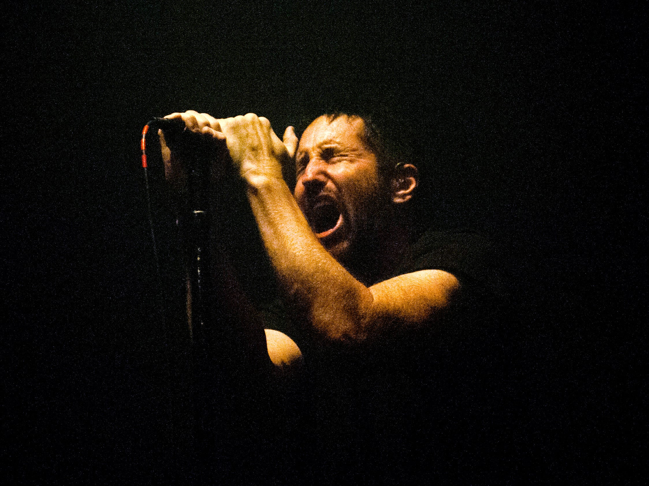 """Nine Inch Nails singer Trent Reznor performs on the first of two nights at the Fox Theatre in Detroit during the band's """"Cold and Black and Infinite Tour"""" on Monday, Oct. 22, 2018."""