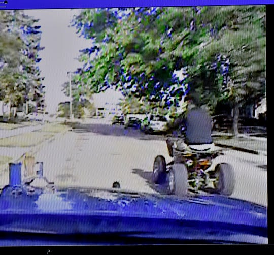 MSP troopers pull up next to teenager Damon Grimes as he rides his ATV as seen on this in-car video during court. This is seconds before  Michigan State Police trooper Mark Bessner allegedly deploys his taser at Grimes.