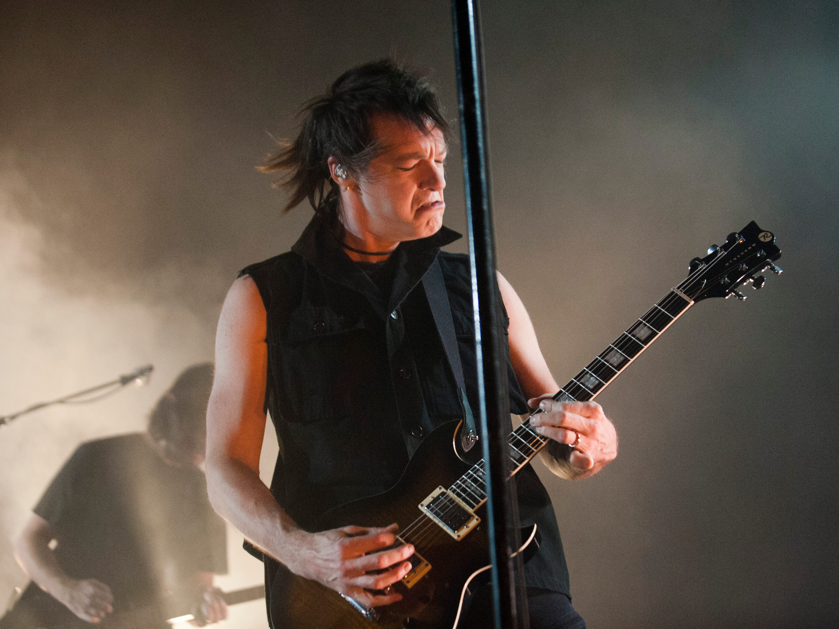 Nine Inch Nails guitarist Robin Finck performs.