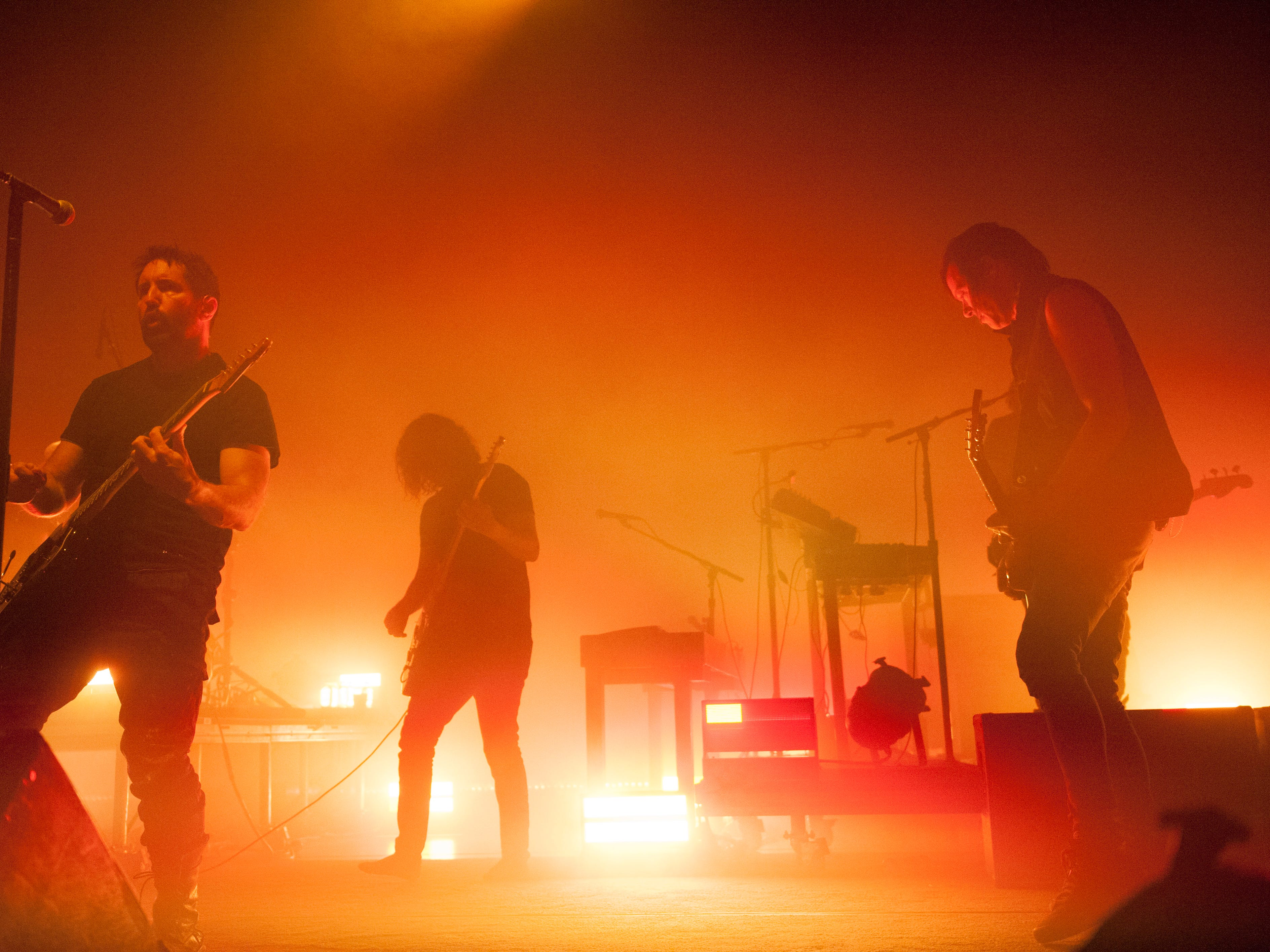 Nine Inch Nails singer Trent Reznor, left, and guitarist Robin Finck perform at the Fox Theatre in Detroit.
