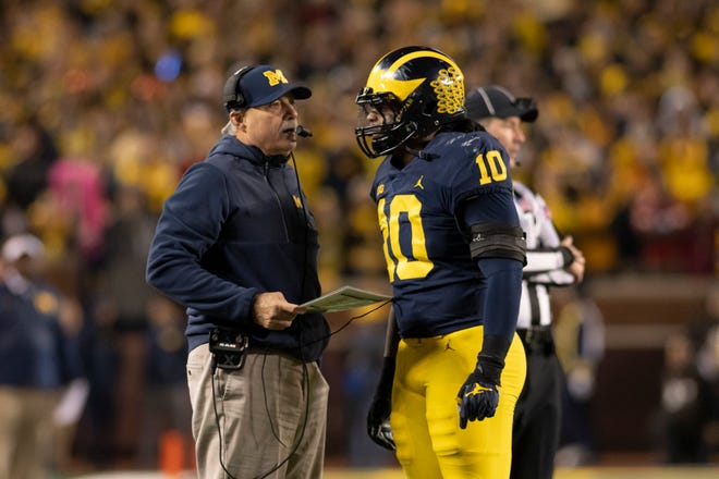 Michigan defensive coordinator Don Brown, left, and linebacker Devin Bush are at the forefront of Michigan's top-ranked defense.