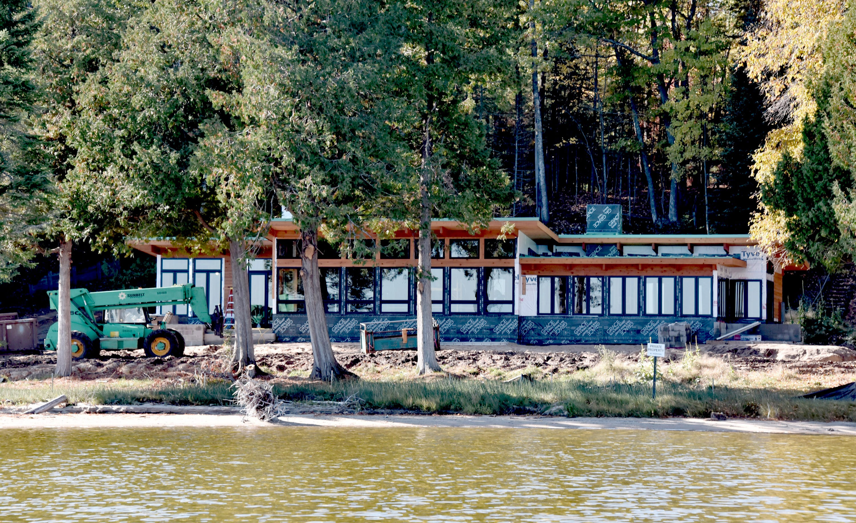 Construction equipment sits outside an unfinished new cottage for retired UAW President Dennis Williams on the UAW property on Black Lake, near Cheboygan.