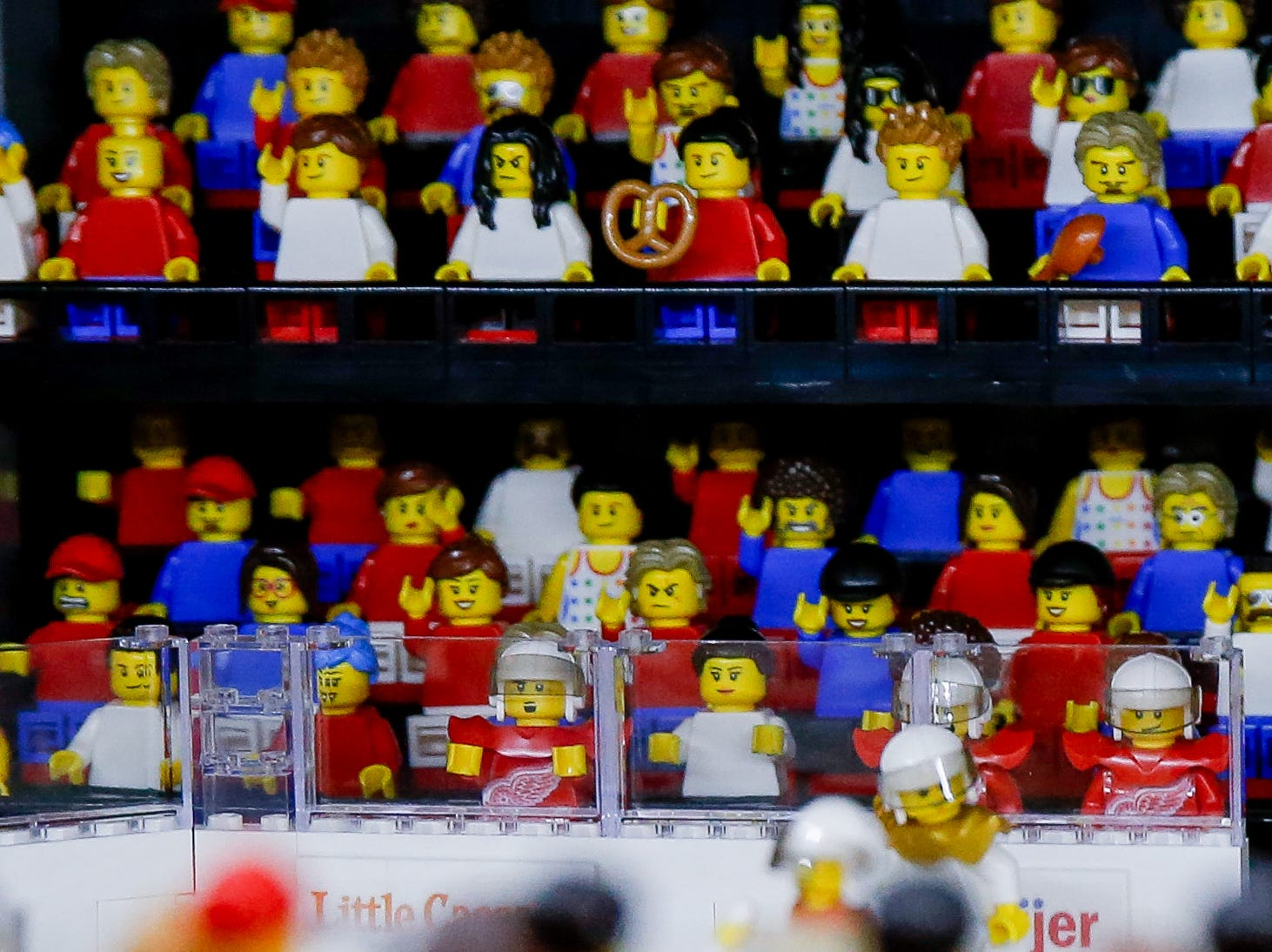 Tiny Detroit Red Wings mini-figures sit on the bench, perhaps waiting for a LEGO Jeff Blashill to insert them into the game.