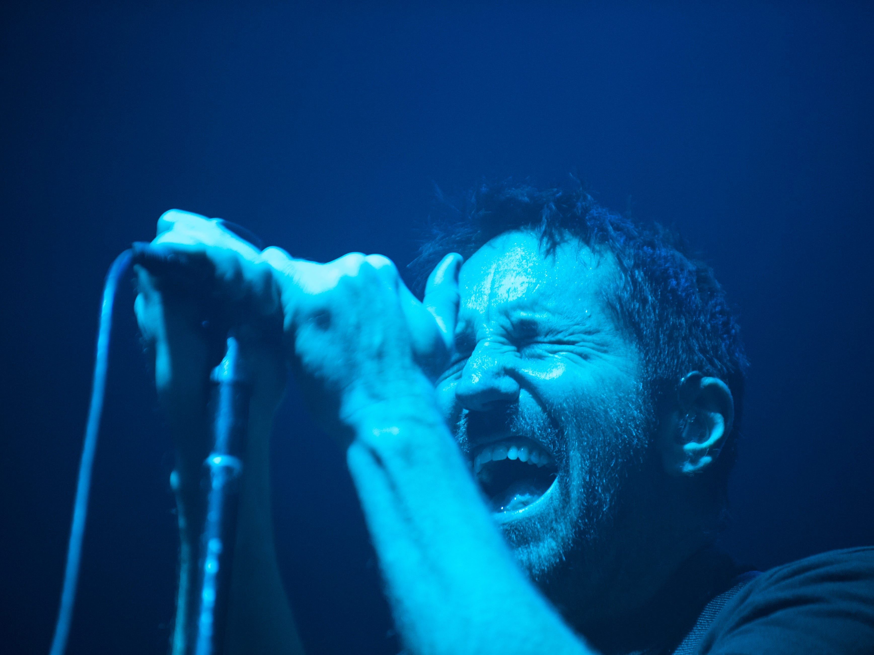 Trent Reznor of Nine Inch Nails performs.
