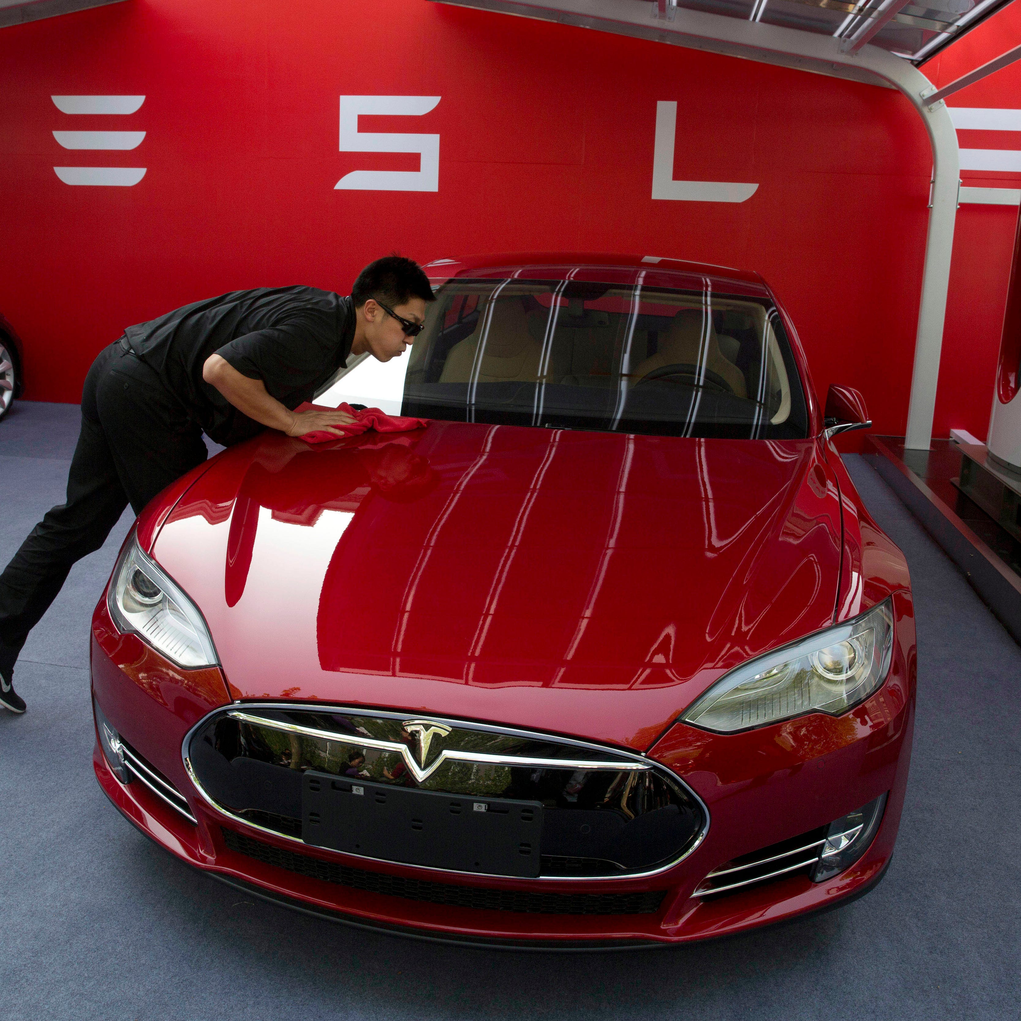 Tesla's rushed earnings could bring profit, company still faces uphill battle