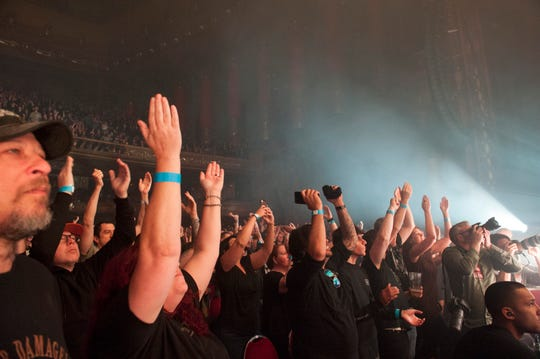 Fans cheer at a Nine Inch Nails concert at the Fox Theatre in Oct. 2018.