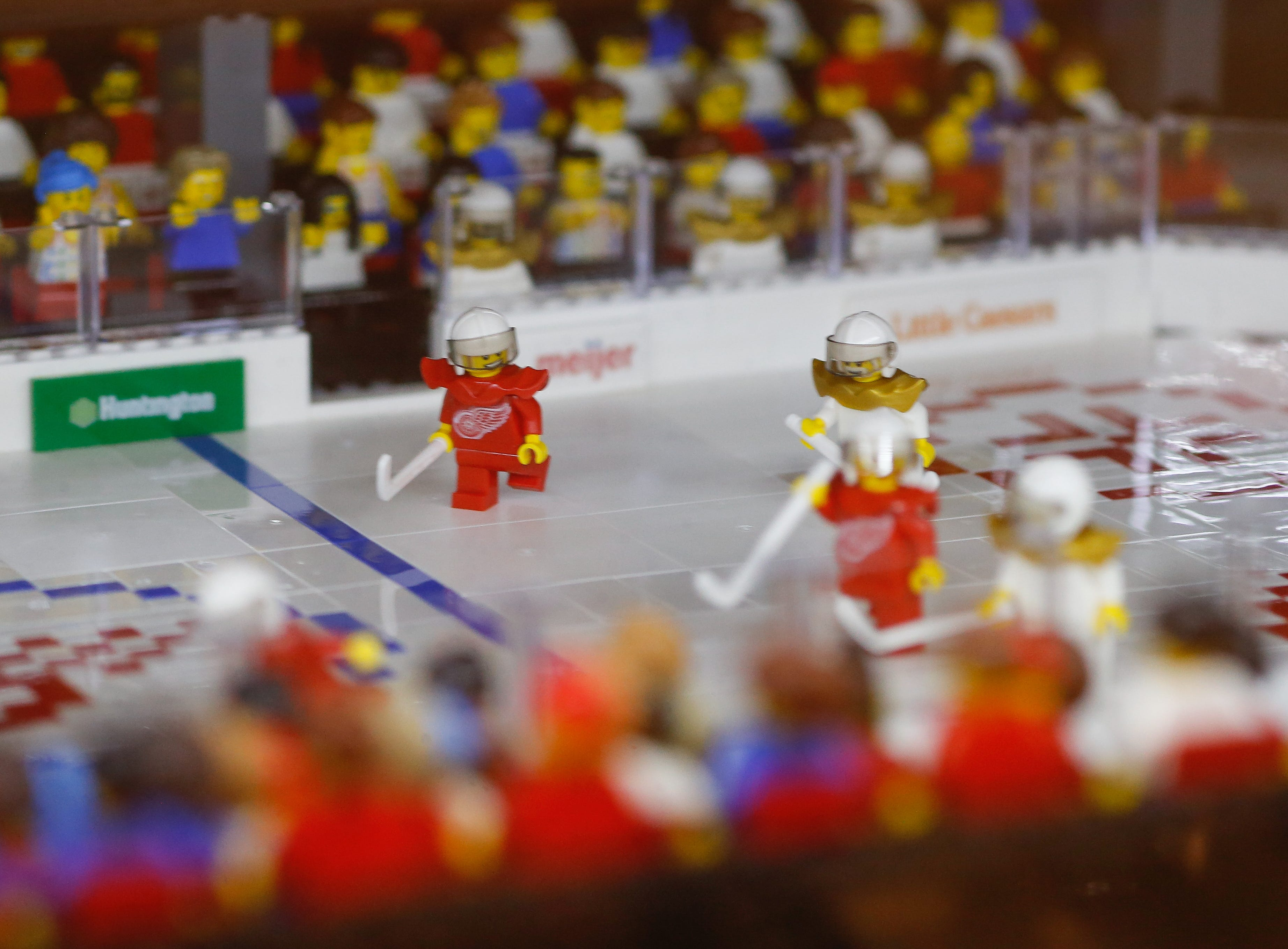 A mini-figure of a Red Wing player skates into the action. Even the boards carry logos of actual sponsors.