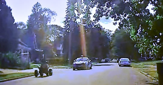 ATV rider Damon Grimes is seen on a DPD in-car camera as he eludes the MSP scout car of defendant Mark Bessner and his partner before he is allegedly shot with a Taser by Bessner.