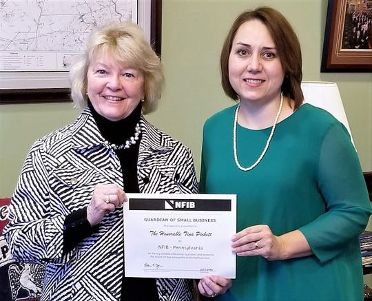 """Pennsylvania state Rep. Tina Pickett, left, accepts a """"Guardian of Small Business"""" award from Rebecca Oyler, state legislative director for the National Federation of Independent Business."""