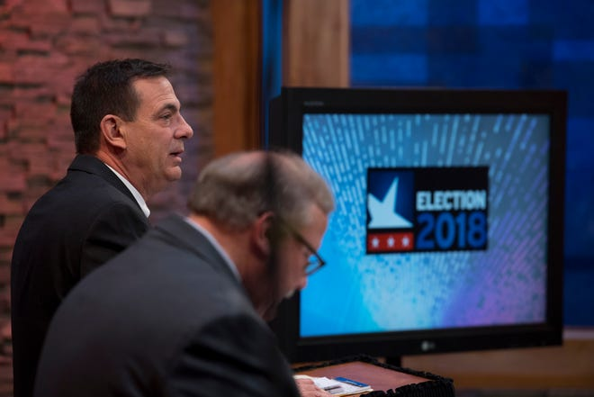 County commissioner candidate – District Two – Jeff Hatfield prepares for the start of his debate against Mike Duckworth at the WNIN studio Monday night.